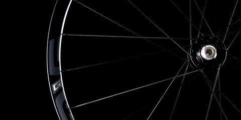 Bicycle wheel, Spoke, Bicycle part, Wheel, Rim, Automotive wheel system, Bicycle tire, Auto part, Circle, Black-and-white,