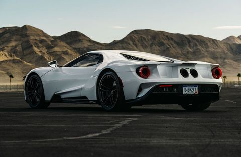 Land vehicle, Vehicle, Supercar, Automotive design, White, Car, Sports car, Wheel, Performance car, Rim,