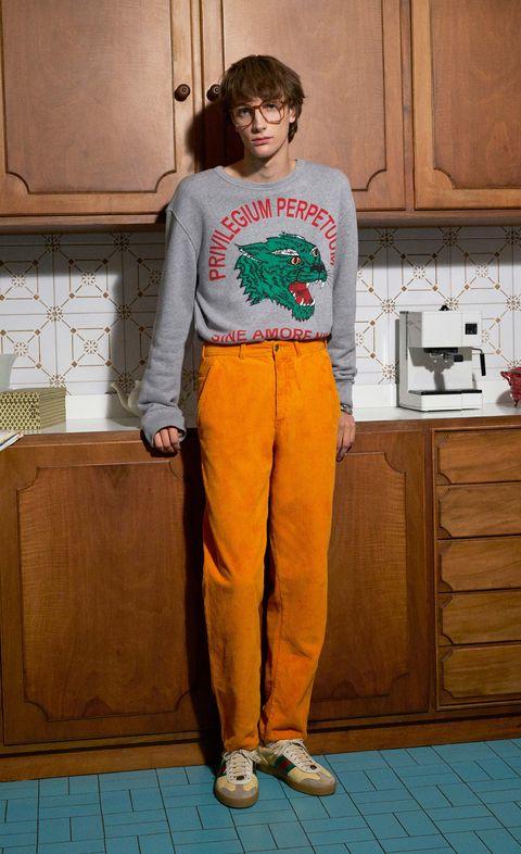Orange, Clothing, Yellow, Standing, T-shirt, Shoulder, Leg, Trousers, Jeans, Waist,