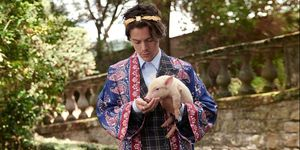 Here are some very important (and super beautiful) pictures of Harry Styles with baby animals