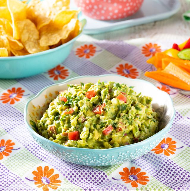 guacamole recipe with tortilla chips and fresh veggies
