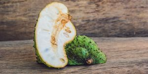 Guanabana on an old wooden background - exotic tropical fruit - regional fruits from Vietnam