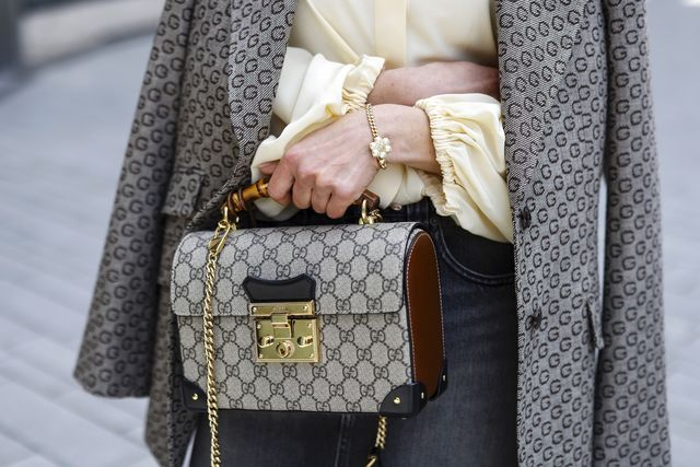 dusseldorf, germany   may 05 a dark brown and beige bag with logo pattern and gold details by gucci and a gold bracelet with pearls by gucci as a detail of influencer gitta banko all by breuninger during a street style shooting on may 5, 2021 in dusseldorf, germany photo by streetstyleshootersgetty images