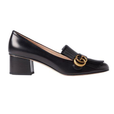 zwarte pump van gucci in loafer stijl met gouden gucci logo via de bijenkorf
