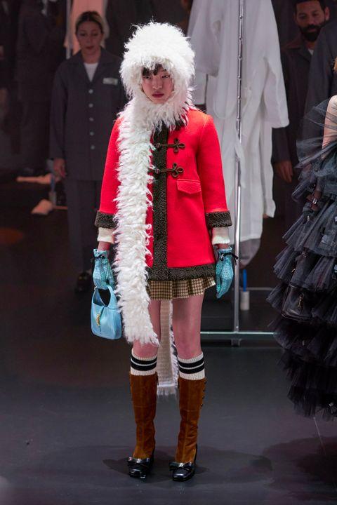 Fashion, Fashion show, Runway, Clothing, Fur, Fashion model, Fur clothing, Street fashion, Footwear, Knee,