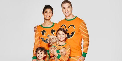 Clothing, Orange, People, Pajamas, Sleeve, Sportswear, T-shirt, Family taking photos together, Child, Smile,