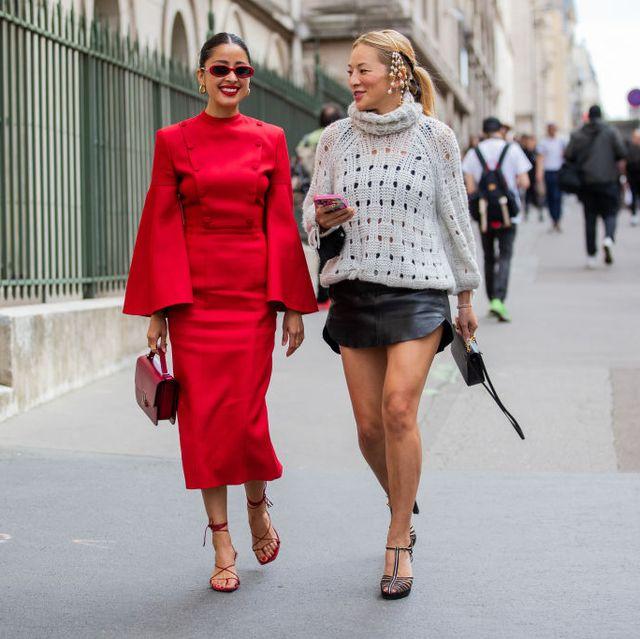 two women walk in paris during paris haute couture week