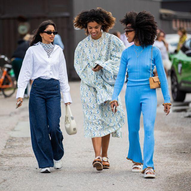 three women walk at copenhagen fashion week