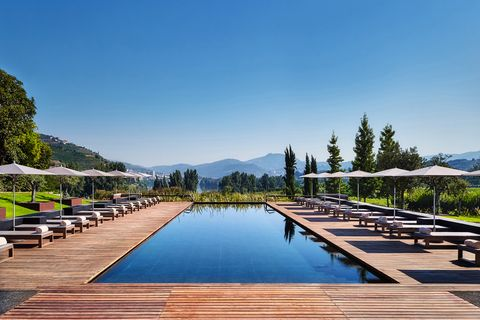 Mountain range, Swimming pool, Hill station, Resort, Reflection, Outdoor furniture, Shade, Resort town, Alps, Sunlounger,