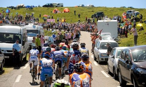 Motor vehicle, Vehicle, Transport, Cycling, Mode of transport, Road cycling, Crowd, Community, Recreation, Bicycle,