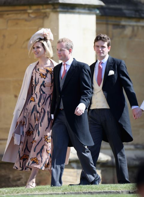 guy pelly centre attending meghan and harry's wedding in 2018, with wife lizzy left and fellow friend of the royals, james meade right