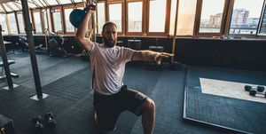 Guy training with kettlebell