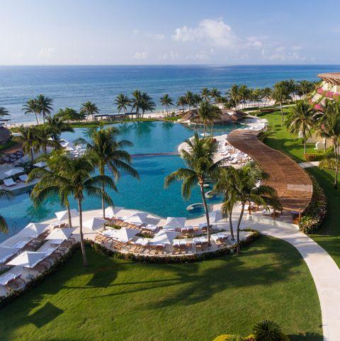 Resort, Swimming pool, Property, Vacation, Resort town, Tropics, Palm tree, Caribbean, Real estate, Tree,