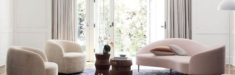 Living room, Furniture, Room, Interior design, Couch, Floor, Coffee table, Curtain, Table, Window covering,