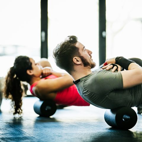 gym goers performing floor exercises together