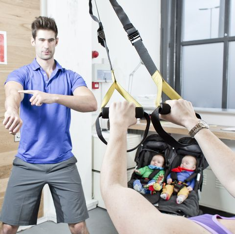Gym instructor conducts session with young female