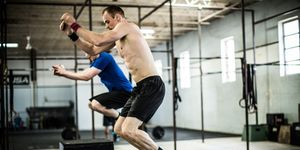 gym - men doing box jumps