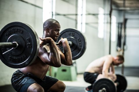 gym   men doing front squats
