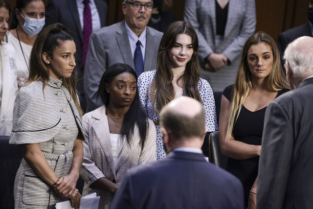 washington, dc   september 15 l r  us olympic gymnasts aly raisman, simone biles, mckayla maroney and ncaa and world champion gymnast maggie nichols are approached by sen pat leahy d vt after their testimony during a senate judiciary hearing about the inspector general's report on the fbi handling of the larry nassar investigation of sexual abuse of olympic gymnasts, on capitol hill on september 15, 2021 in washington, dc biles and other fellow us gymnasts gave testimony on the abuse they experienced at the hand of larry nassar, the former us women's national gymnastics team doctor, and the fbi's lack of urgency when handling their cases photo by anna moneymakergetty images