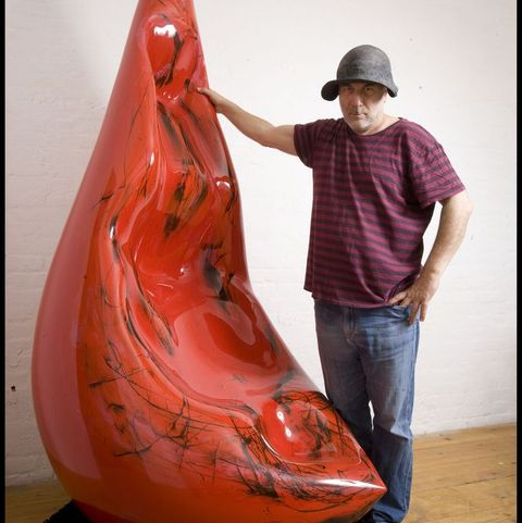 Portrait of Ron Arad with red sculpture