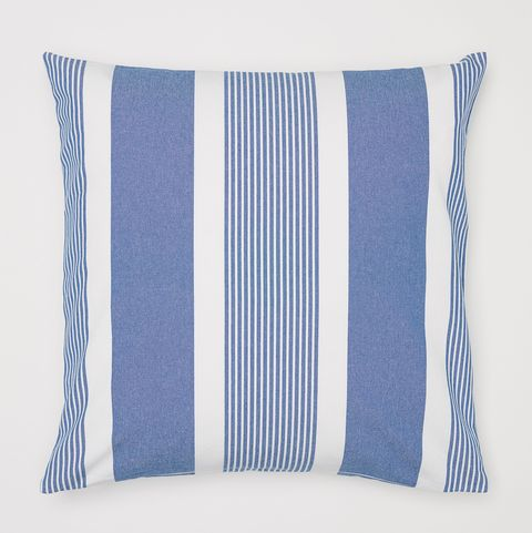 white and blue striped cushion