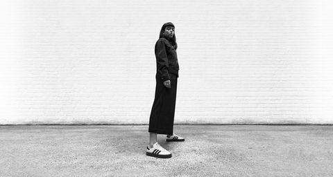 White, Black, Standing, Black-and-white, Snapshot, Outerwear, Footwear, Street fashion, Fashion, Human,