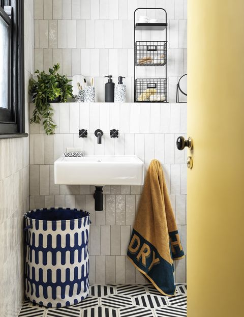 bathroom with storage and white tiles