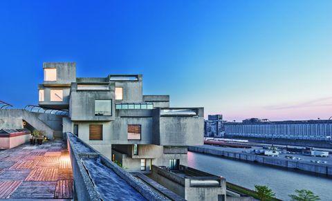 Architecture, Urban area, Sky, Metropolitan area, Daytime, Roof, City, Town, Building, Bridge,