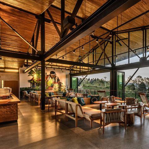 Furniture, Table, Restaurant, Beam, Hardwood, Outdoor table, Outdoor furniture, Resort, Houseplant, Outdoor structure,