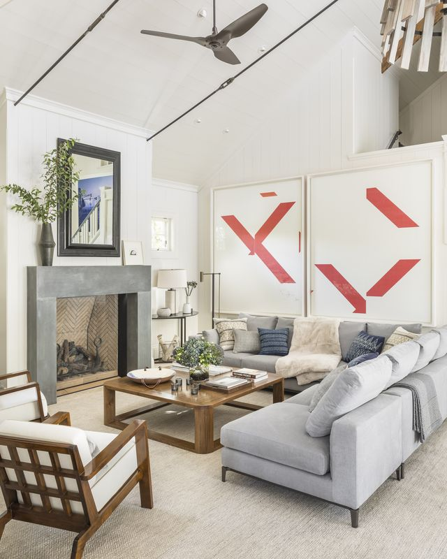 living room, fireplace, gray sofa, artwork