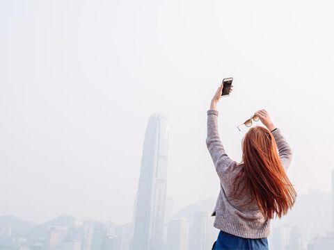 Atmospheric phenomenon, Tower block, Tower, Travel, Haze, Long hair, Metropolis, Street fashion, Back, Mist,