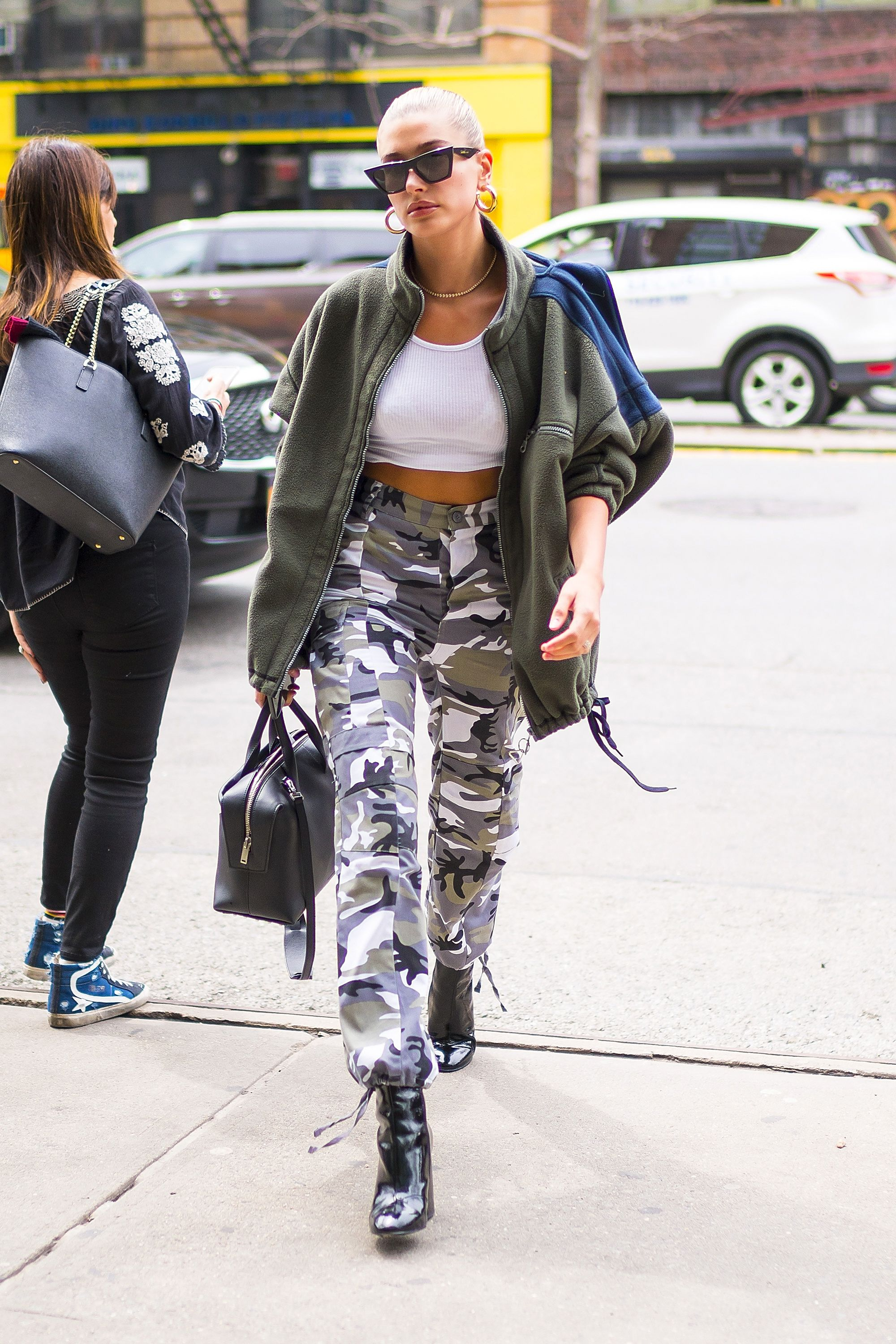 Hailey Baldwin When the weather's nice and you want to show off your midriff, a crop top is the best option. To avoid baring it all though, opt for high-waisted pants like a cool pair of camo bottoms and an oversized fleece jacket JIC it's still chilly.