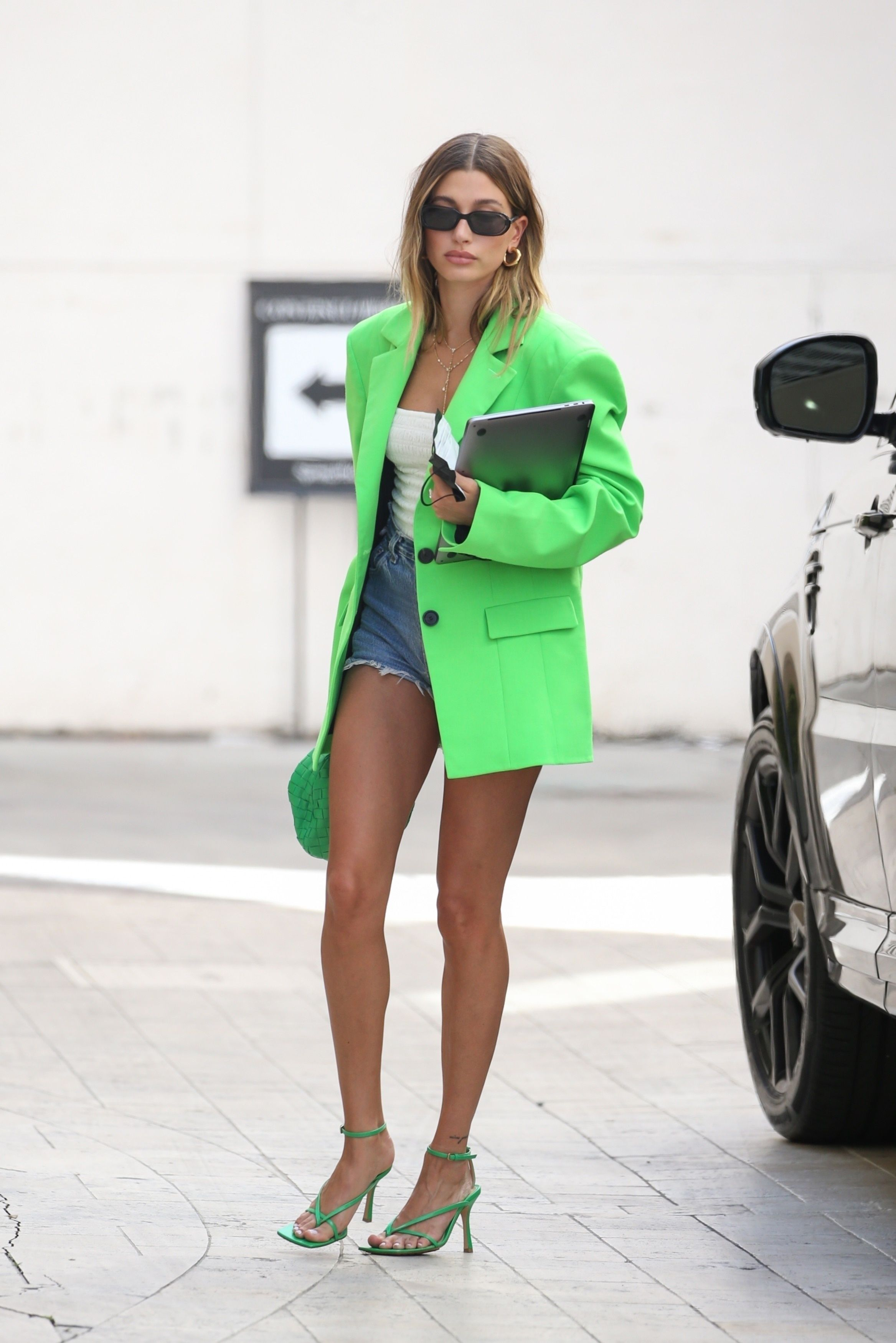 Hailey Bieber Paired Short Shorts With a Neon Green Blazer and Heels for a Business Meeting