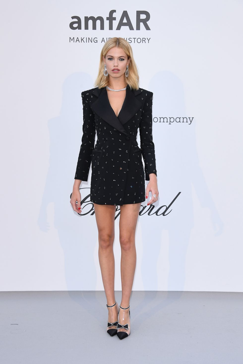 Hailey Clauson In a long-sleeve black blazer dress.