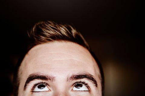 man looking at his hair line