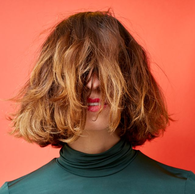 woman with hair in front of her face