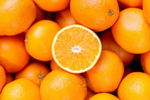 half of the orange on the orange pile