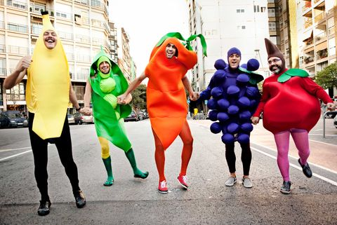 Friends running in fruit and vegetable costumes