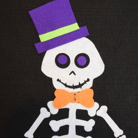 halloween games - pin the bone