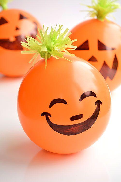 halloween party games candy filled balloon pumpkins