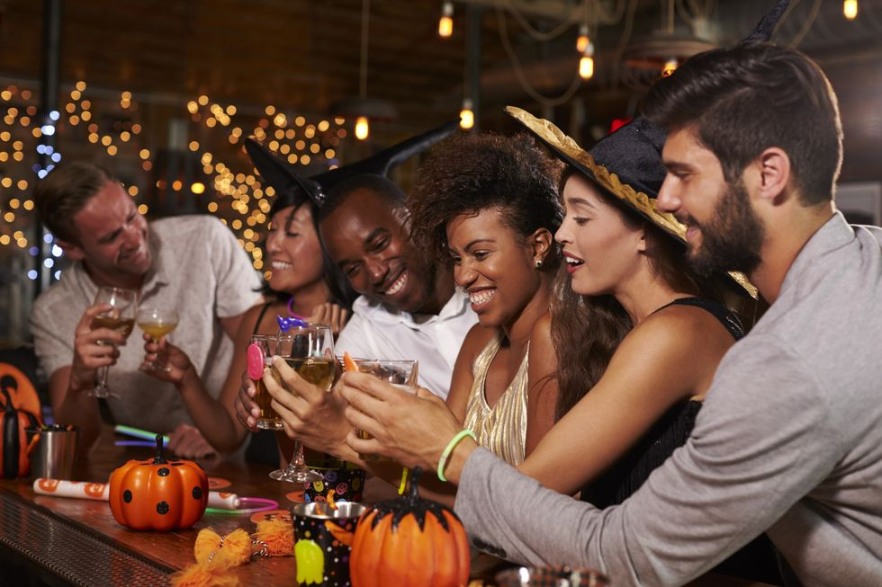 35 Halloween Party Games for Adults That Are Just as Good as Trick-or-Treating