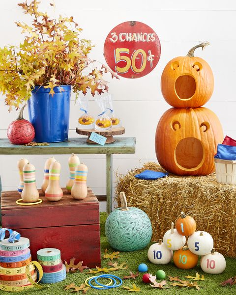 fair themed pumpkins decorated like ring toss and knockover game and bean bag toss
