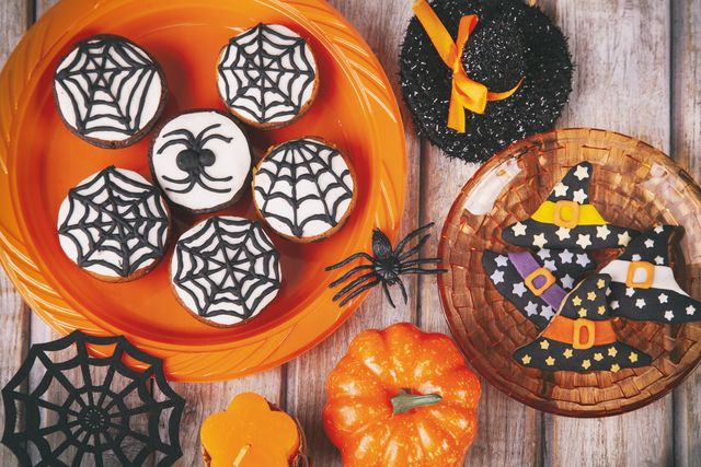halloween party with homemade gingerbread cookies on white rustic wooden table