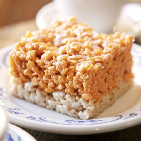 pumpkin spice cereal treats on blue and white plate