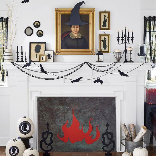 halloween party setup with fireplace pumpkins and bats