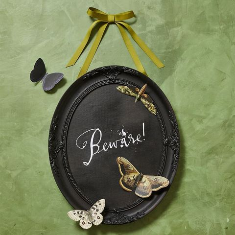 beware vintage frame with butterflies