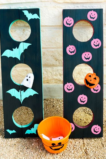 halloween bean bag toss with bucket and wooden boards