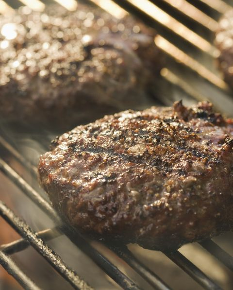 beef patties on grill, close up