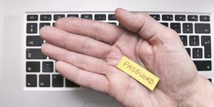 Hand holding note saying Password
