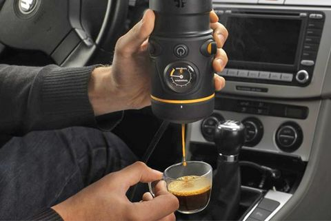 Gear shift, Steering wheel, Steering part, Center console, Vehicle, Car, Driving, Auto part, Small appliance, Home appliance,